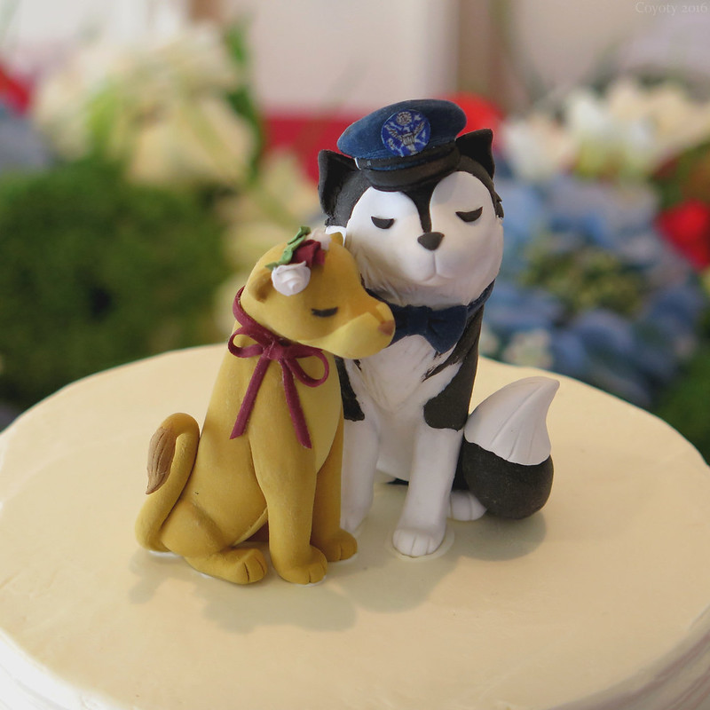 Lion and husky wedding cake topping