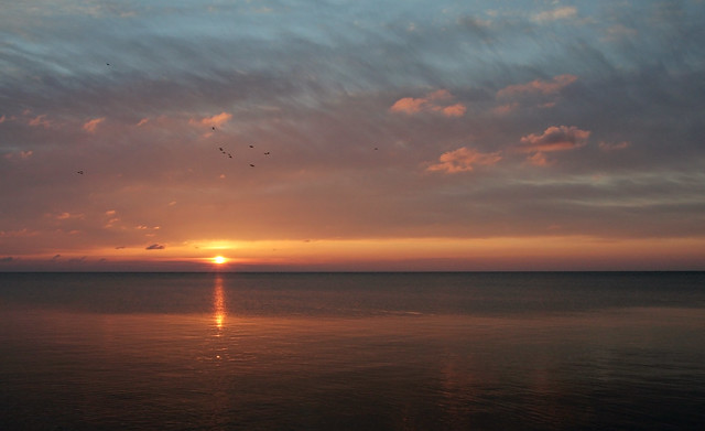 the sun rises over Lake Superior