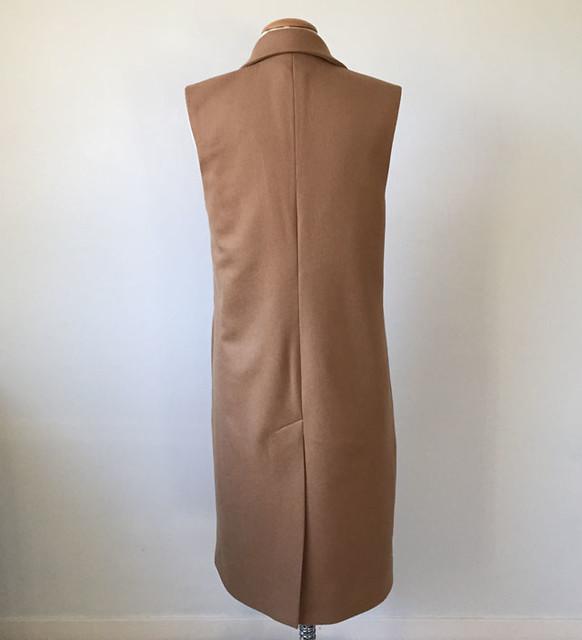 camel coat on form back view