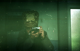 reflected self-portrait with Voigtlander VF101 camera and ornate hat