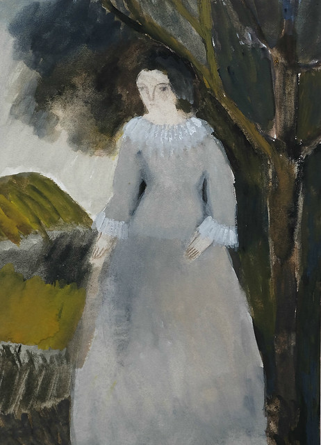 young woman in grey with landscape
