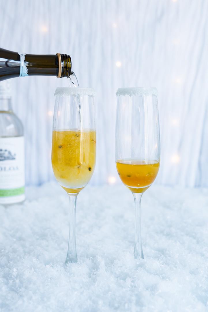 Coconut Passion Fruit Champagne Cocktails #Drinkmas www.pineappleandcoconut.com