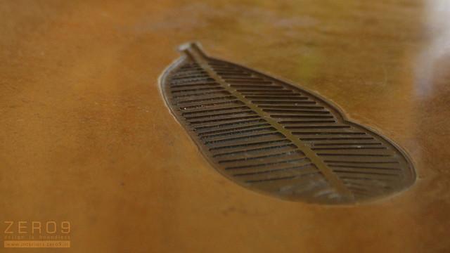 brass leaves insert on the floor