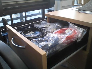 Office drawer full of network cables