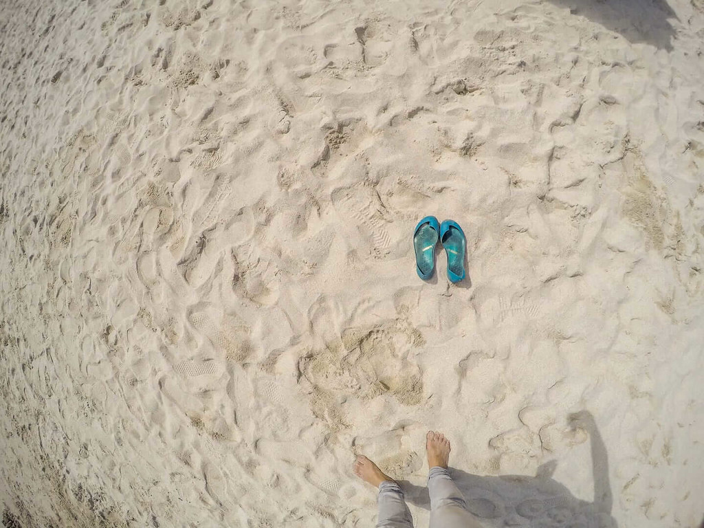 Iguaneye shoes from above on sand