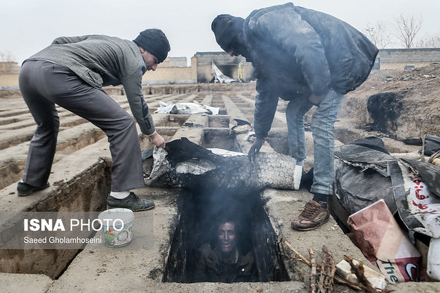 In pictures: homeless Iranians find shelter from cold in empty graves