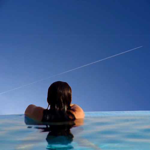 woman at rest - minimal streaking the blue sky | by oddsock