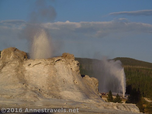 Castle Geyser and Beehive Geyser erupt simultaneously in the Upper Geyser Basin of Yellowstone National Park, Wyoming