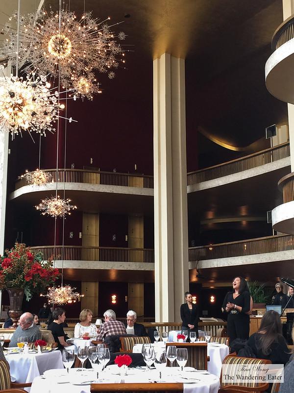 Interior of Grand Tier Restaurant and sopranist, Michelle Bradley, hitting a high note