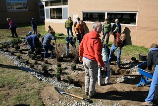 Mike Dietz (in the red hoodie) oversees construction of a rain garden as part of his rain garden training.