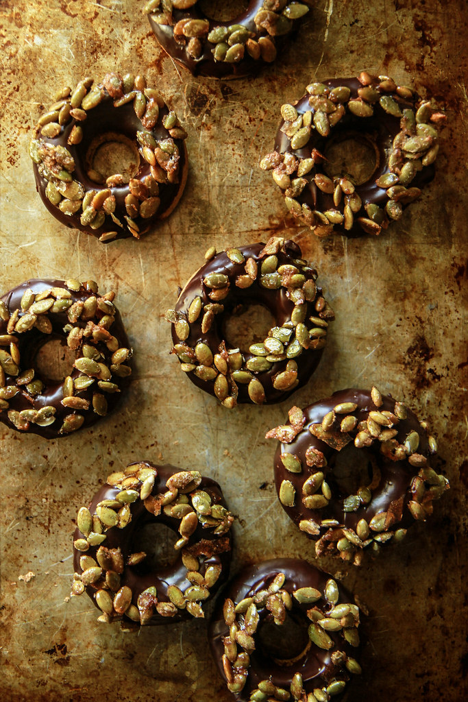 Pumpkin Ginger Donuts with Chocolate Ganache and Candied Pepitas- Vegan and Gluten Free