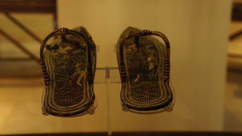 King Tut's black and golden sandals
