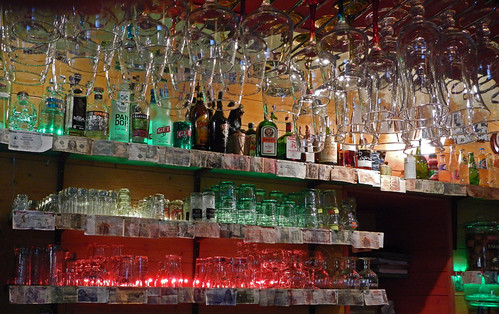 Lit-up glasses in a Dieppe bar, France