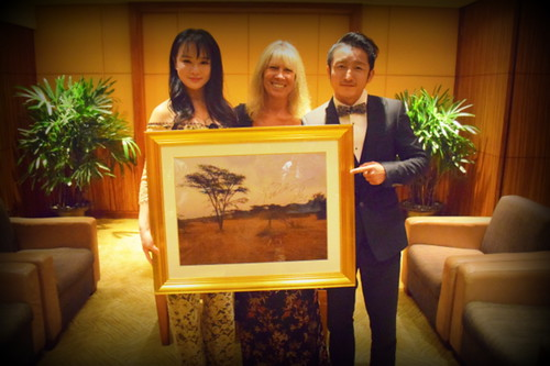 Jill Robinson with Olympic boxer Zou Shiming and his wife by Stech @ Precis magazine