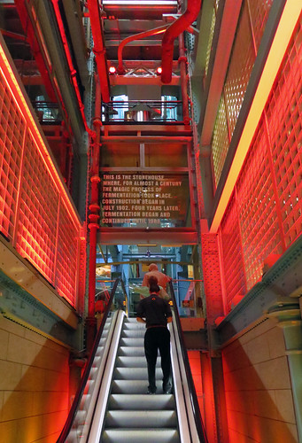 A Red Escalator Leads Upwards at the Guinness Storehouse in Dublin Ireland