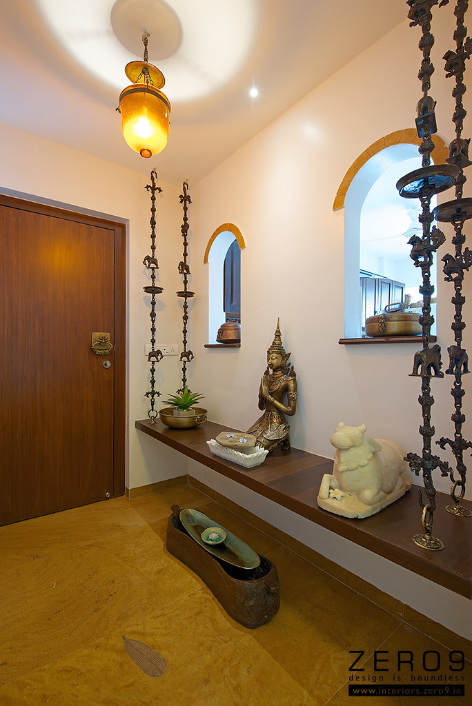 Ethnic foyer with a wooden swing