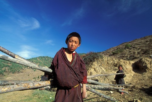 Portrait of boy carrying wood. Bhutan | by World Bank Photo Collection