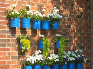 Blue painted cans act as a wall container, Toronto, Canada | by Happy Sleepy