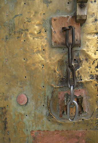 Details of a brass and copper metal door in the Udaipur, India