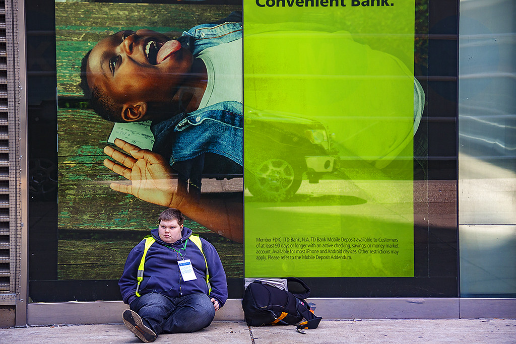 Obese young man on ground and girl with tongue sticking out--Center City