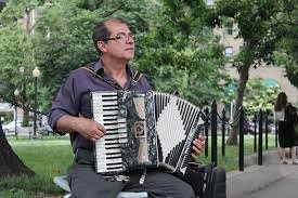 Juventino Villeda plays his accordion. Photo by Barbara Corbellini Duarte.