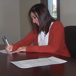me signing one of the many mortgage papers.