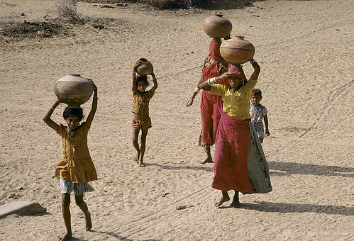 Women and children carry water | by World Bank Photo Collection