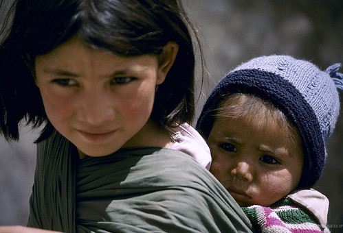 Portrait of young girl carrying an infant | by World Bank Photo Collection