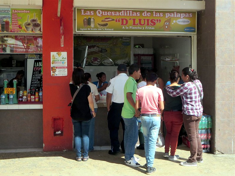 People standing in front of Las Quesadillas D'Luis