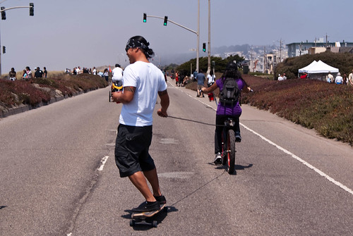 08405 Skateboarder towed along the Great Highway approaching Rivera | by sfbike