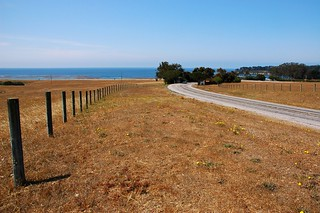 Looking towards San Simeon dock from the road to Hearst Castle, fence, road, tree, Pacific Ocean, San Simeon, Southern California, USA | by Wonderlane