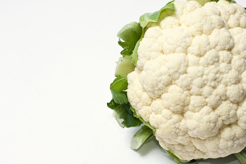 Part of a white cauliflower with leaves on the side | by Horia Varlan