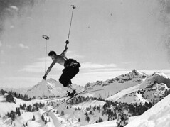 Skier making a cornice jump near Edith Creek, Mount Rainier | by UW Digital Collections