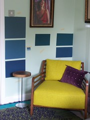 rug, chair and frames are all staying. We have purple, yellow and a touch of green in the rug. by FloxP