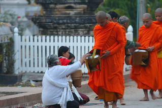 Giving alms | by DiGiSLR