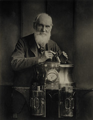 Sir William Thomson, Baron Kelvin, 1824 - 1907. Scientist, resting on a binnacle and holding a marine azimuth mirror | by National Galleries of Scotland Commons