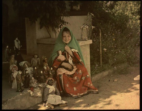 Girl with collection of dolls | by George Eastman House