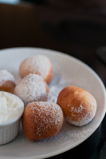 bite sized donuts with powdered sugar from Lamill by food photographer Jackie Alpers | by Jackie Alpers