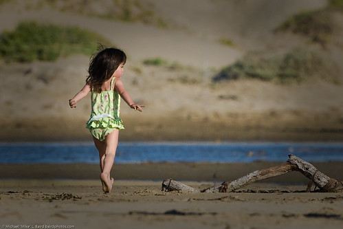 Small child runs on Morro Strand | by mikebaird