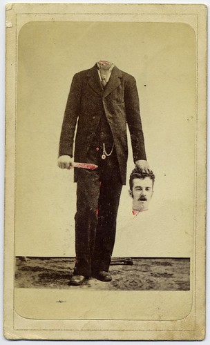 Trick photo, decapitated man with bloody knife, holding his head | by George Eastman House