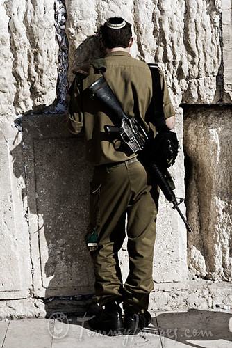 IDF soldier praying at the Western Wall | by tommyimages_com