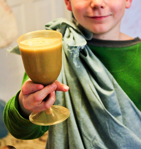 "a happy child with his ""potion"" 