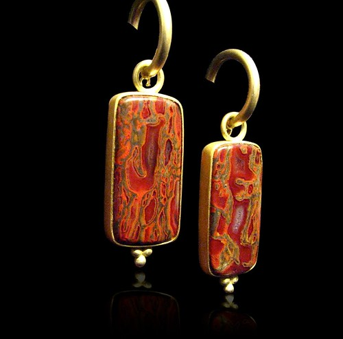 22k reversible earrings with gem dinosaur bone