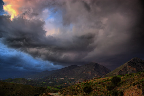 Clouds over mountains | by Theophilos