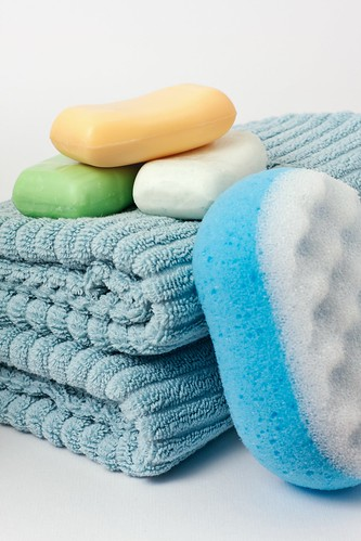 Soap bars on two folded blue towels | by Horia Varlan
