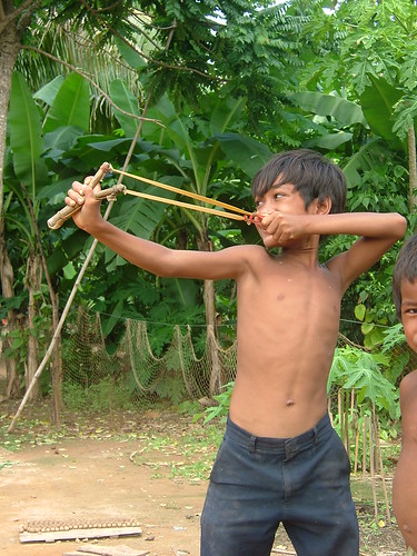 Boy playing with catapult, Siem Reap, Cambodia