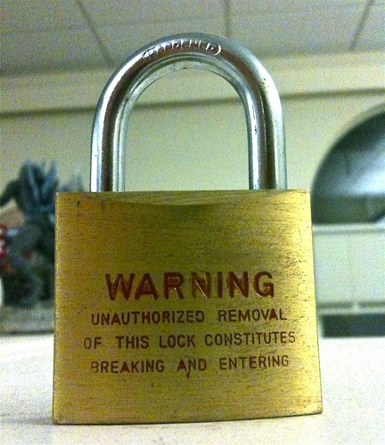 A lock with a warning on it