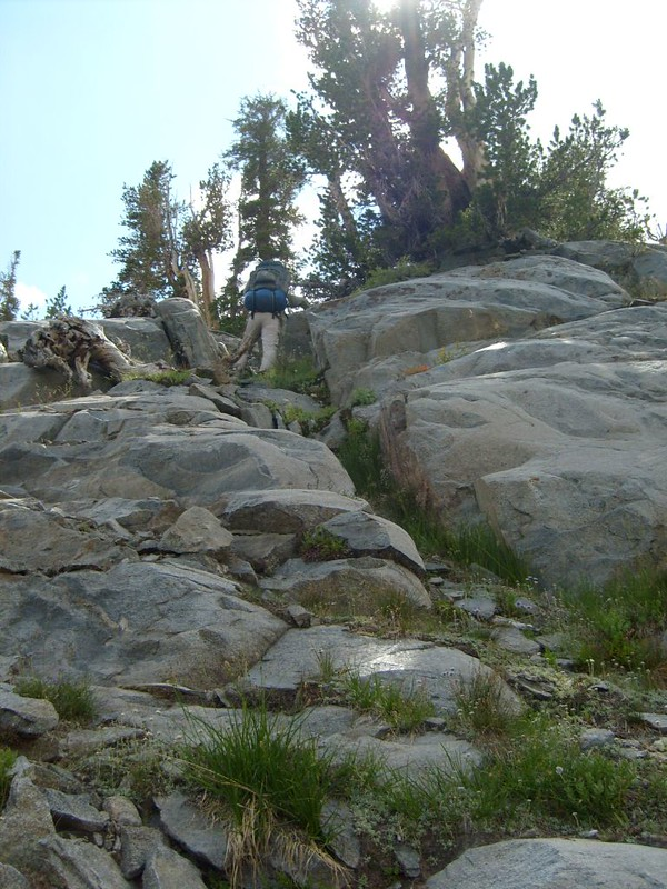 Scrambling up some granite slabs to avoid the loose talus slope