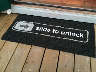 """Slide to unlock"" doormat 
