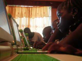 20090730-Students in the first week of class and one of the volunteers, Vandy, helping to teach-Edit.jpg | by One Laptop per Child